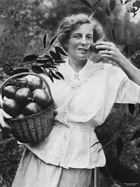 woman with a basket of mandarins